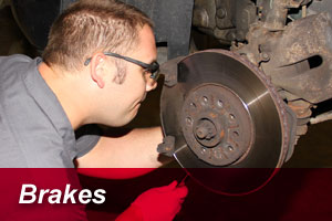 photo of working on car brakes